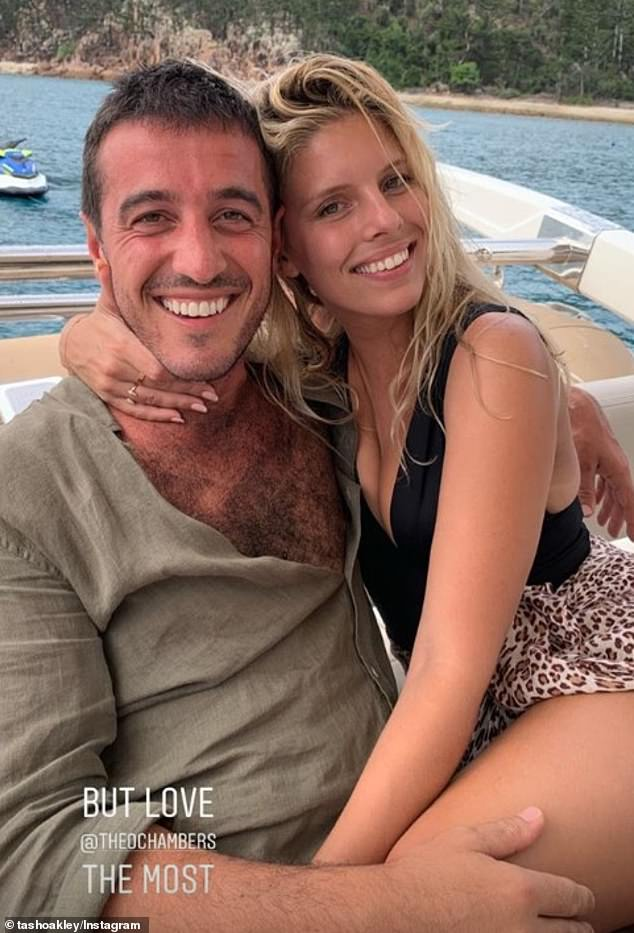 Joy: Natasha Oakley and her boyfriend Theo Chambers looked every inch the happy couple as they relaxed on a boat with friends in the Whitsundays on Saturday