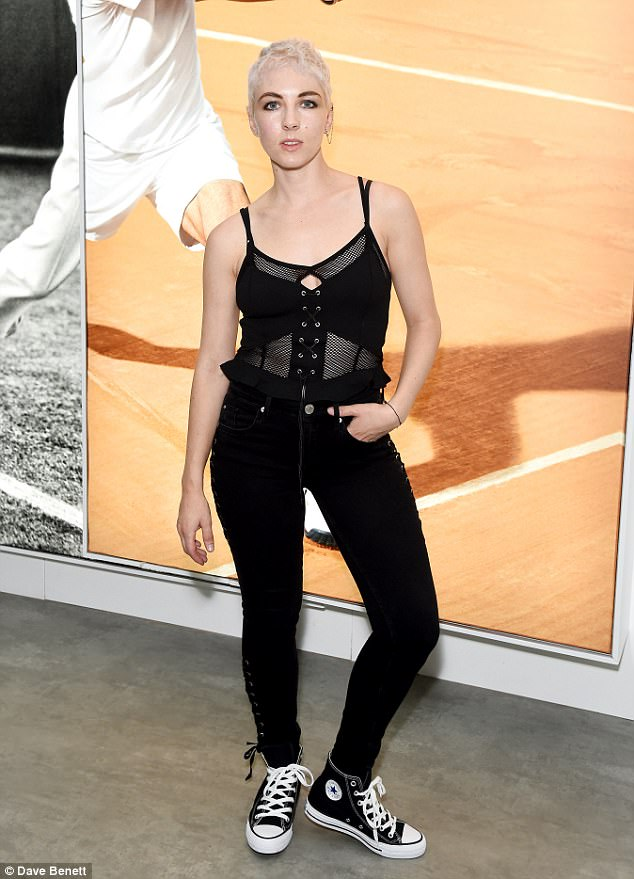 Chilling out: The pop star just released her new single 'Fire with Fire' last Friday rocking black and white Converse and was styled by River Island Style Studio wearing an all-black ensemble
