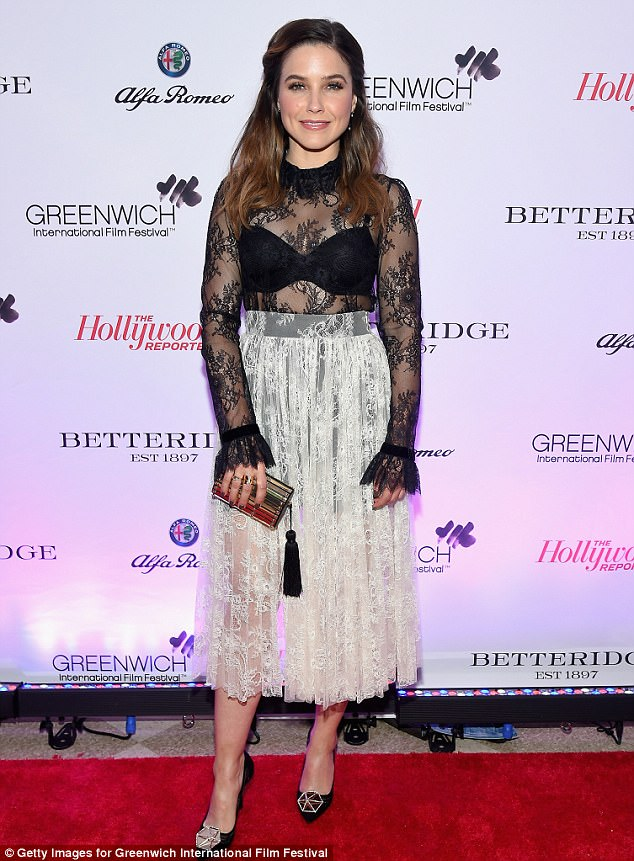 Flirty fun: Sophia Bush flashed her cleavage and her shapely legs in this semi sheer lace dress she wore for Friday's opening gala of the Greenwich International Film Festival in Connecticut