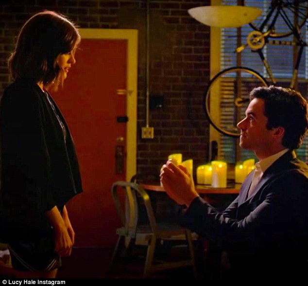 'Sorry to keep y'all hangin!' Lucy apologised to fans who will have to wait until August 2 to find out whether Aria says yes to Ezra Fitz, played by Ian Harding, in an Instagram snap taken from Tuesday's Pretty Little Liars