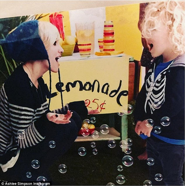 Birthday boy: She uploaded a sweet Instagram photo of herself and Bronx standing in front of a small lemonade stand