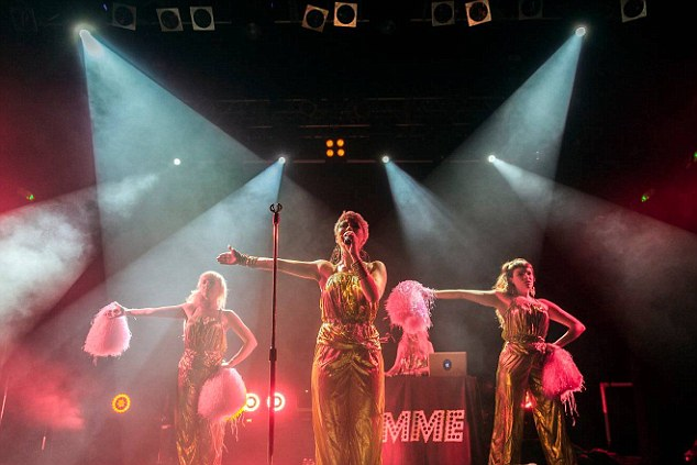 """On Stage: The pop star performing at KOKO in London with her backup dancers """"The Bullet Girls"""""""