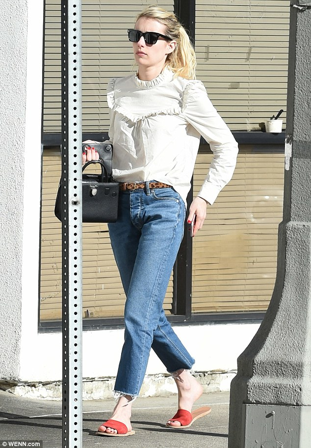 Effortless: The 25-year-old star opted for a cream-colored ruffle top, tucked into a pair of cropped denim jeans and topped it off with red flats