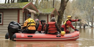 Ryan Lance, front, and Anthony Nash of the Russian river fire protection district swift water rescue team rescue residents of Sycamore Court Apartments.