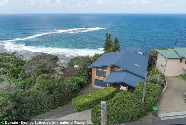 New digs: The couple live in a $3 million '1970's-style' Newport house (pictured), perched on the headland and overlooking the ocean