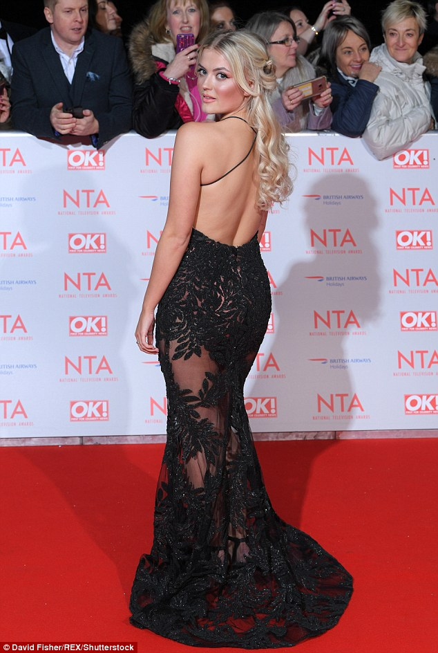 Stunner: Lucy looked gorgeous at the National Television awards, where she wore a backless sheer gown