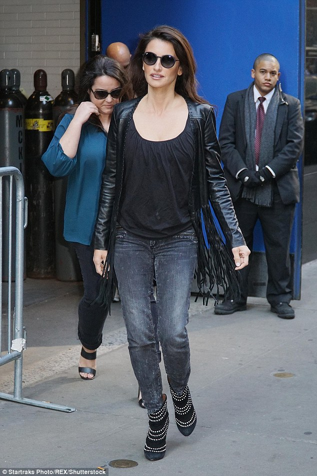 Cool in black: The Vicky Cristina Barcelona finished off her arrival look with a leather fringe jacket