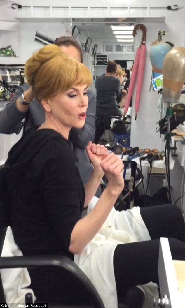 Working around: All the while, her stylist was trying to put the finishing touches on her immaculately blonde bun in preparation for shooting a scene of her upcoming TV show Big Little Lies